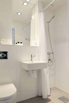 image 0051 One Room Apartment in Stockholm Showcasing an Ingenious Interior Design Small Bathroom Layout, Simple Bathroom Designs, Modern Bathroom Design, Bathroom Colors, White Bathroom, Bathroom Ideas, Narrow Bathroom, Bathroom Furniture, Bathroom Wall