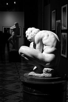 Crouching Boy.    The exhibition in the Twelve-Column Hall of the Hermitage museum presented sculptures by the outstanding Italian master Michelangelo (1475-1564) and photographs by Aurelio Amendola. The exhibition was prepared by the State Hermitage together with the Bargello National Museum in Florence.