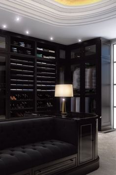 Prestigeous Walk-in Closet. Clean lines with an inclusion of Art Deco elements. Black Metro Walnut Dressing Room - The Clive Christian Contemporary Collection.