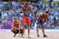 (L-R) Michael Bultheel of Belgium, Felix Sanchez of Dominican Republic and Eric Alejandro of Puerto Rico look on after the Men's 400m Hurdles Semi Final on Day 8 of the London 2012 Olympic Games at Olympic Stadium on August 4, 2012 in London, England. (Photo by Streeter Lecka/Getty Images)