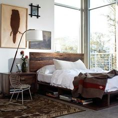 Love the bedframe and the wool blanket