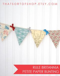 Rule Britannia!  This very British bunting includes papers printed with a vintage London map, British brollies (umbrellas), and Liberty print-inspired florals in a color scheme of red, aqua, grey, and ivory.