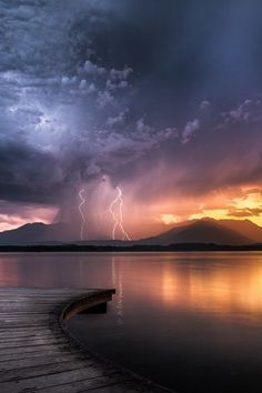 Lightning at sunset, Lake Viverone, Italia
