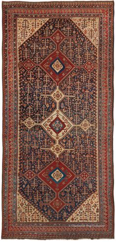 Antique rug woven by the Qashqai tribe in 19th century Persia.