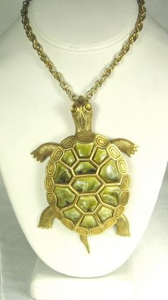 SALE: WAS $129.99  NOW  $89.99  A vintage movable #turtle necklace. This amazing item is a movable piece having the arms and legs of the turtle attached and dangling from a ... #pendant #plastic #glass #amber #judysgems2