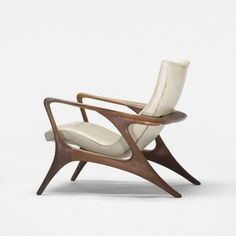 I would love for one of these to fall into my hand-  Vladimir Kagan - Contour lounge chair