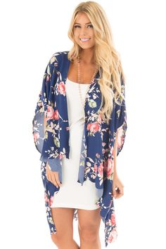 Lime Lush Boutique - Navy and Blush Floral Print Scalloped High Low Kimono, $38.99 (https://www.limelush.com/navy-and-blush-floral-print-scalloped-high-low-kimono/)