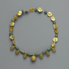 A Late Roman/Parthian gold and green glass bead necklace