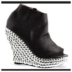 HP. Jeffrey Campbell wedge bootie Jeffrey Campbell's Tic bootie: genuine black leather upper with studded wedge and peep toe. Inside zipper for easy dress. Fun and trendy style adds pop to any outfit. True size 10 Jeffrey Campbell Shoes Wedges