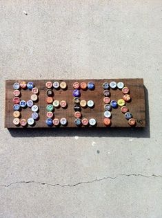 Hammer beer bottle or cola caps onto a   piece of wood to create sign for garage or man cave home decor; upcycle,   recycle, salvage, diy, repurpose!  For ideas and goods shop at Estate ReSale   & ReDesign, Bonita Springs, FL #beerdecor #beerideas