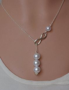 Silver lariat Infinity Pearl necklace Infinity pearl lariat Bridesmaid Necklace Drop pearl necklace Infinity Pearl necklace Bridesmaid gift – Cute Pins For You :) Diamond Initial Necklace, Pearl Drop Necklace, Lariat Necklace, Necklace Ideas, Pearl Necklaces, Necklace Display, Infinity Necklace, Jewelry Necklaces, Necklace Guide