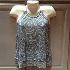 ON SALE! 20% OFF!!! Super Cute Old Navy Summer Top Super cute! Halter style with built in shelf bra. Black and cream flowered pattern. Braided tie at neck with layered detail at hemline. Not sure of material but I think its a poly/spandex blend as its very soft and flowing but has some stretch as well. Size small. Old Navy Tops