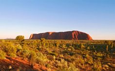 Uluru, Northern Territory No collection of unusual landscapes in Australia would be complete without the best known of them all, Uluru (Ayers Rock), the huge sandstone rock formation plonked in the middle of the desert (nearest town Alice Springs, which is 280 miles away). Uluru is actually taller than the Eiffel Tower. It is part of an area sacred to the local Aboriginal people, and visitors are strongly discouraged from climbing. It is also a world heritage site.
