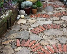Like mixing stones and bricks in my garden.  Not sure about this design, but makes me think about brick AND stone for the pathway around the shed.