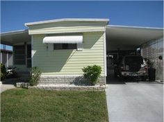 NEW FOR SALE: 3210 Hampshire Dr, Holiday, FL 34690 $38,900 - Check out this 2 bedrooms,1 1/2 bathroom split plan singlewide in an active 55+community. Newer laminate wood floors in kitchen and living room. 1/2 bath in 2nd bedroom. Great screened lanai to enjoy the Florida sunshine. — My Florida Regional MLS #: W7606506