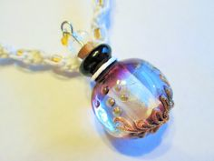 Hand Blown Glass Purple Perfume Essential Oil Bottle Pendant on Handmade White Hemp Twist Necklace with Gold Glass Beads by EssentiallyErin on Etsy