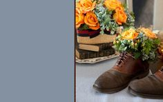 What does an old leather pair of shoes, plastic or foil liner, floral foam, and flowers make? A great planter gift or decoration for a father's day brunch or other party...cute way to keep a pair of shoes you love but don't wear, or a remembrance from a grandpa/dad.