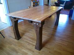 hand crafted from reclaimed canadian hardwood this uniquely designed one of a kind timber frame construction dinner table is the pure definition of
