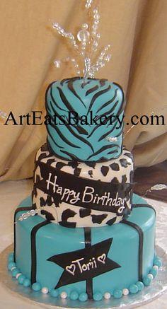Three tier black white and turquise fondant cheeta and zebra print unique girl's birthday cake with bead topper