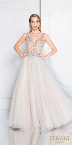 Wow the crowd in the Beaded Two Tone V-Neck Prom Ball gown by Terani Couture. This beautiful dress has a fully beaded bodice with plunging neckline and V-shape open back and two tone layered chiffon and tulle ball skirt. #edressme