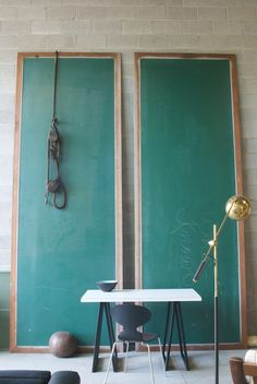 old classroom chalkboards placed vertically. art and decor in one!