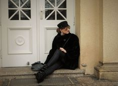 SHADES OF K by Karen  wearing  a black fake fur coat, black coated jeans, ankle boots, wedges, mirrored sunglasses, silver jewellery, hoop earrings, winter outfit, street style, Isabel Marant Vibes