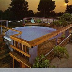 I like these ways to put a deck around an above ground pool