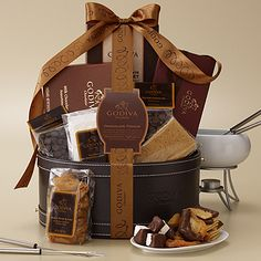 Our Godiva Chocolate Fondue Gift Basket includes all of the fondue necessities: a white porcelain fondue pot and base, 4 stainless steel color-coded skewers, and a tea light, along with GODIVA Melting milk and Semisweet Dark chocolate. Also included are dried pears, graham crackers, marshmallows, an 8 pc. Signature Truffle Assortment and a 15 pc. Milk Chocolate Assortment. A perfect way to spend a night enjoying each other's company. (2 lbs., 8.5 oz.)
