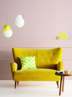 This is an off-yellow way to brighten up your TV room. Throw in some other colors for a punch of style! #yellow #trend #colorblocking