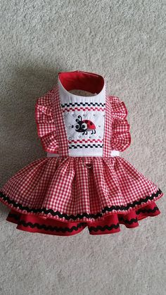 Description Practical and fashionable excellent quality made with attention to detail Limited edition. Darling Ladybug Dress, velcro closure. Please note this is very strong velcro. Excellent Quality Dog clothes :) Teddy Face Items are tailored for small dog breeds & puppies .