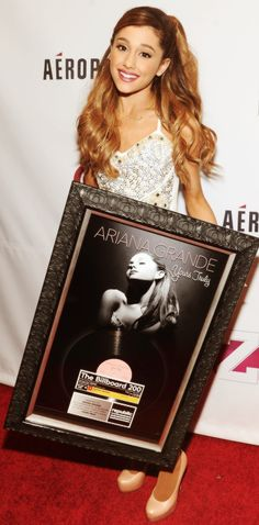 Ariana Grande Holding a Picture Frame of her in her Yours Truly Album Picture.:).