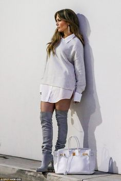 Always camera ready! Jennifer Lopez turns shopping trip into a modelling shoot as she poses against a wall on Saturday