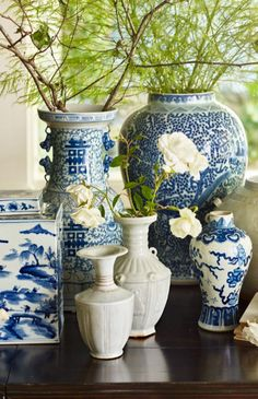 a cluster of ginger jars and greenery weu0027re