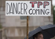 Demonstrators protest against the TPP in Washington, DC in May 2015