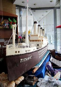 Titanic cake with painted skewers and string attached to pegs. I might be able to do twinkies as the smokestacks, attached via inside skewers. I'm about 90% sure I would NOT be able to handle this complicated of a cake. LOL