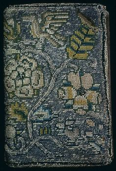 England    Book Cover for Book of Psalms, Prayers, and Hymns, 17th century    Linen, plain weave; embroidered with silk and gilt-metal-strip-wrapped silk in plaited braid and tent stitches; raised darning  9.8 x 6.4 cm (2 1/2 x 3 7/8 in.)