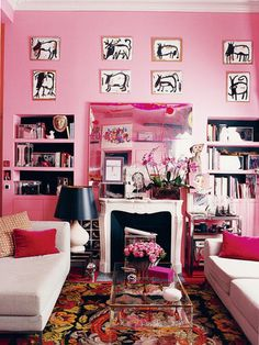 Splattered pink paint on the mirror above the mantle adds edge to this feminine space. Source: Pascal Chevallier for Domino