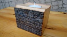 This Handmade hand crafted wooden candle holder is made from old pine wood . It is a natural material - the texture of this wood is all natural . Candle holder is made without any decorations or whatsoever to even more show the texture and real beauty of the material it is made from .Finished with lacquer Dimensions: 7.5 cm X 7.5cm X 7cm Thanks for visiting my shop