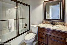 Traditional Full Bathroom with Flush, tiled wall showerbath, Complex granite counters, Undermount Sink, Drop-In Bathtub