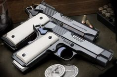 "georgebeast: "" A pair of custom 1911 model Supergrade Heirloom done by Wilson Combat of Arkansas. Engraving on the side reads ""Because We're Men."" Turnbull charcoal bluing and case color hardening. Weapons Guns, Guns And Ammo, Colt M1911, 1911 Pistol, 1911 Grips, Custom 1911, Wilson Combat, 45 Acp, Cool Guns"
