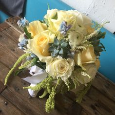 Lily pad lovely bouquet pale yellow garden roses, tweedia, alstilbe and succulents