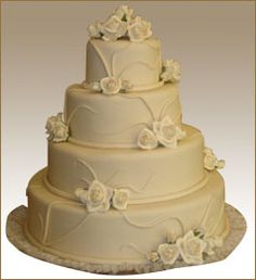 White Elegant Wedding Cake Accented With Fondant Vines and Roses