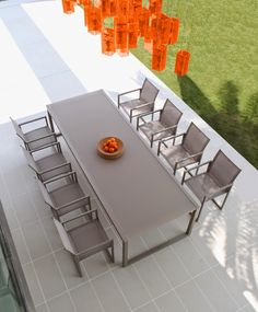 NINIX designed by Kris Van Puyvelde for Royal Botania - Belgium. NINIX garden dining tables are a modern geometrical design and are made with brushed or powder coated stainless steel base, with table tops in toughened glass, ceramic or teak. Wide range of dining table and bar table sizes, in a wide range of colour finishes.