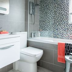 Compact grey bathroom with glittering green mosaic tiles