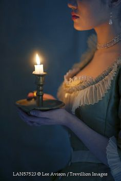 © Lee Avison / Trevillion Images - historical-woman-with-candle