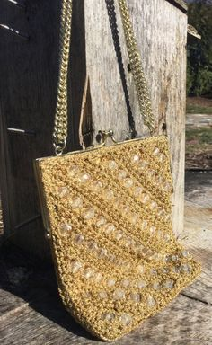 A #1960s Flapper-Style gold crocheted clutch. #vintageclutch #vintageetsy #vintagefashion