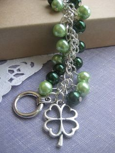 Shamrock charm cluster green glass pearl bracelet. on Etsy, $15.00