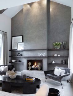 Polished concrete fireplace in a home in Yorkshire, UK designed by Fiona Barratt