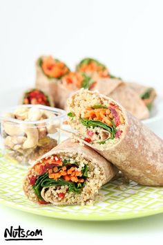 Quinoa Veggie Wraps {Vegan} - We love how colorful these easy-to-make veggie wraps are! Healthy and delicious, these quinoa & hummus wraps are perfect for lunch or dinner. #veggie #wraps #recipe