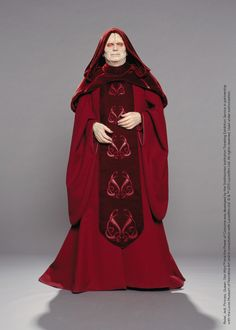 Through ornament, color, and texture, Darth Sidious' red robes reflect Palpatine's metamorphosis from the seemingly benevolent Senator in Episode I to the evil, despotic Emperor in Episode III. Design by: Trisha Biggar #StarWarsCostumes #behindtheseams